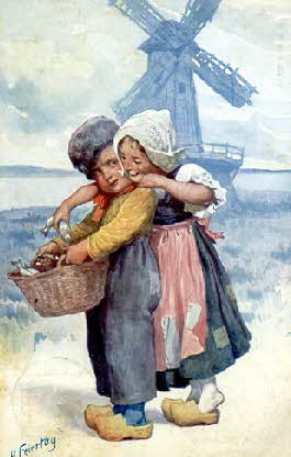 Dutch_boy_and_girl_in_front_of_windmill
